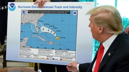 Donald Trump in Oval Office with altered Hurricane Dorian projection map