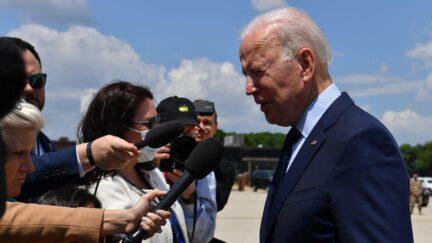 President Joe Biden talks to reporters