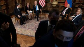 Russian security personnel and others push the press out as US Secretary of State Antony Blinken (L), US President Joe Biden (3rd L), Russia's President Vladimir Putin (2nd R), and Russia's Foreign Minister Sergey Lavrov (R) wait for the US-Russia summit at Villa La Grange in Geneva on June 16, 2021. (Photo by Brendan Smialowski / AFP) (Photo by BRENDAN SMIALOWSKI/AFP via Getty Images)