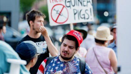 NEW YORK, NEW YORK - JUNE 20: An anti- vaccination activist wears a