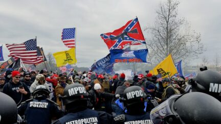 Trump supporters clash with police and security forces as they storm the US Capitol in Washington D.C on January 6, 2021. - Demonstrators breeched security and entered the Capitol as Congress debated the a 2020 presidential election Electoral Vote Certification. (Photo by Joseph Prezioso / AFP) (Photo by JOSEPH PREZIOSO/AFP via Getty Images)