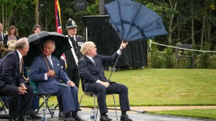 Boris Johnson with an inverted umbrella