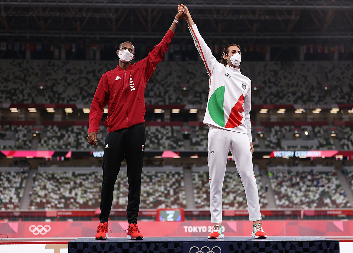 Joint gold medalists Mutaz Essa Barshim of Team Qatar and Gianmarco Tamberi of Team Italy celebrate on the podium during the medal ceremony for the Mens High Jump on day ten of the Tokyo 2020 Olympic Games at Olympic Stadium on August 02 2021 in Tokyo Japan