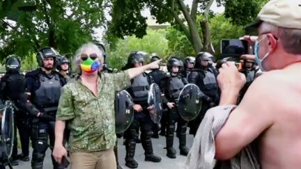 Man Hectors Pro-Riot Rally, Gets Into Shouting Match As Dozens of Riot Cops Look On