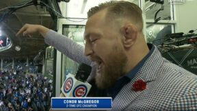 Conor McGregor sings during the seventh-inning stretch at Wrigley Field