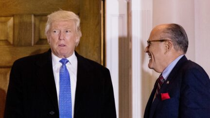 BEDMINSTER TOWNSHIP, NJ - NOVEMBER 20: (L to R) President-elect Donald Trump and former New York City mayor Rudy Giuliani exit the clubhouse following their meeting at Trump International Golf Club, November 20, 2016 in Bedminster Township, New Jersey. Trump and his transition team are in the process of filling cabinet and other high level positions for the new administration.