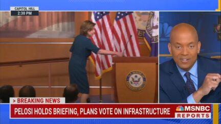 House Speaker Nancy Pelosi (D-CA) grabs mask